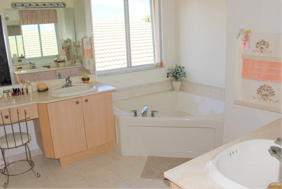 additional builder upgrades in the master bathroom.... builder upgraded jetted jacuzzi tub, upgraded kohler sink package and marble countertops....